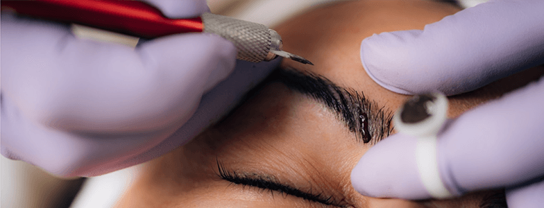 aesthetician performing microblading